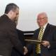 "14. Ovidiu FOLCUȚ receiving the ""Diploma of Excellence"" with silver commemorative coin"