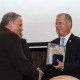 """18. Dinu AIRINEI receiving the """"Diploma of Excellence"""" with silver commemorative coin"""