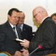 "9. Nicolae ISTUDOR receiving the ""Diploma of Excellence"" with silver commemorative coin"